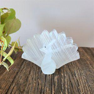 Marble peacock napkin holder.
